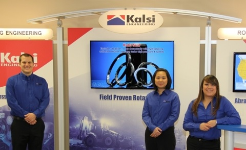Image of Kalsi Engineering staff members and sealing technology booth.