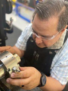 Figure 1: An engineer assembling a rotary shaft seal test.