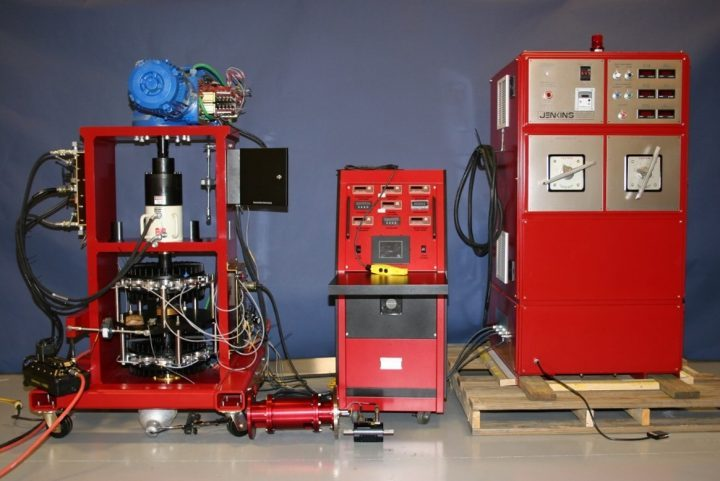Figure 1 Torque and Thrust Test Bench (left), Control Cabinet (center), and Power Supply Cabinet (right)