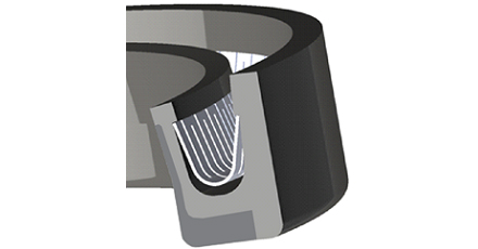 This shows the cross-section of the KLS lip seal. The dynamic lip is loaded against the shaft by a V-spring. The HNBR seal body is reinforced by a high-performance extrusion resistant plastic liner. Because of the hydrodynamic waves formed by the liner, KLS seals outperform conventional PTFE lip seals in high pressure operating conditions.
