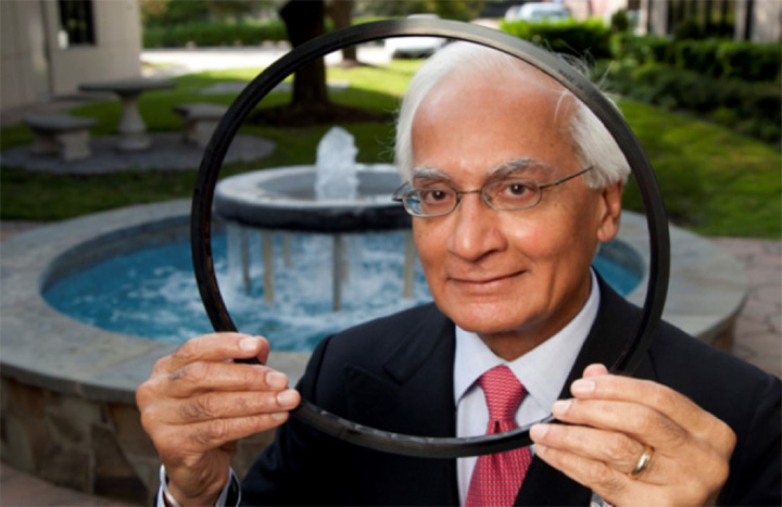 M. S. Kalsi, PhD, founder and President of Kalsi Engineering, Inc. poses with one of the company's various types of hydrodynamically lubricated rotary shaft oil seals.